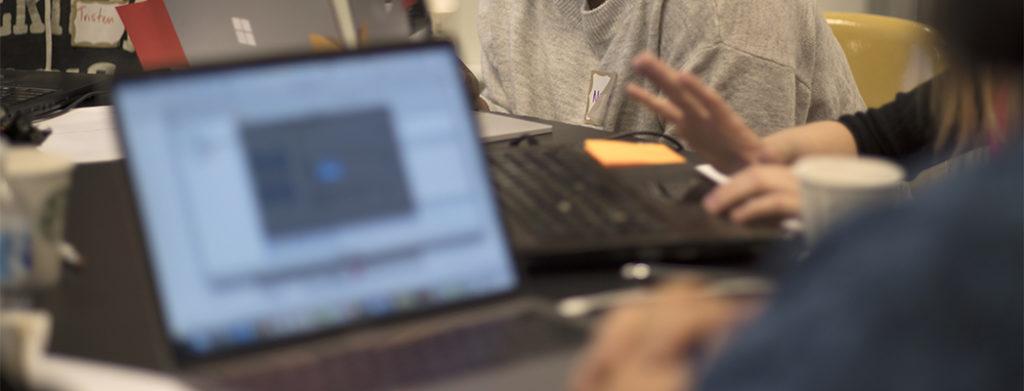 hands typing on laptop keyboard multiple