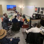 bird's eye view of digital scholarship lab; people sitting at table talking.