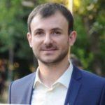 Headshot, Andi Çupallari